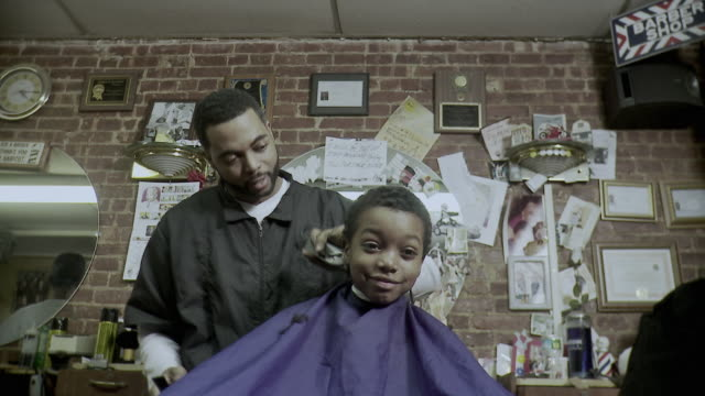 ms boy (8-9) having haircut done at barbershop, brooklyn, new york city, new york state, usa - shaving stock videos and b-roll footage