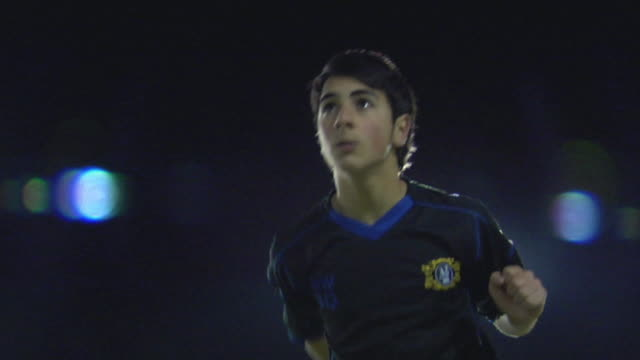 ms la boy (14-15) heading ball, london, uk - geköpft stock-videos und b-roll-filmmaterial