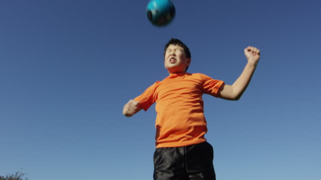 boy heading soccer ball - one boy only stock videos and b-roll footage