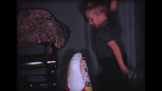1959 boy hits punching bag, opens xmas presents - punch bag stock videos & royalty-free footage