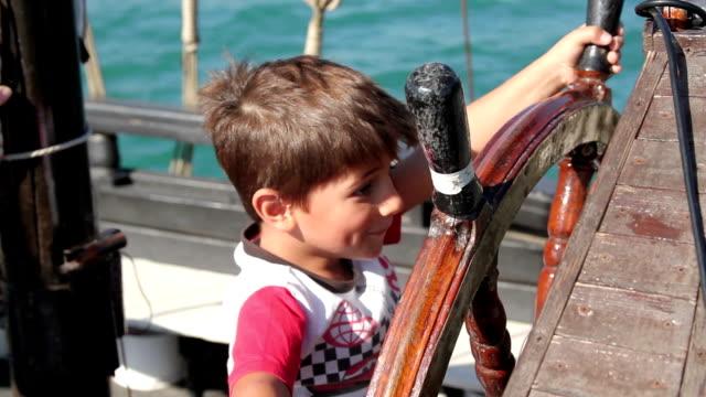 boy holding an steering wheel