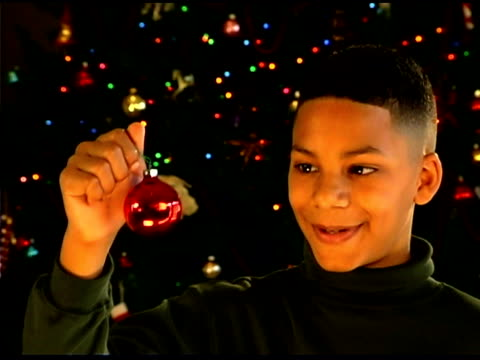 boy holding christmas ornament - see other clips from this shoot 1407 stock videos and b-roll footage