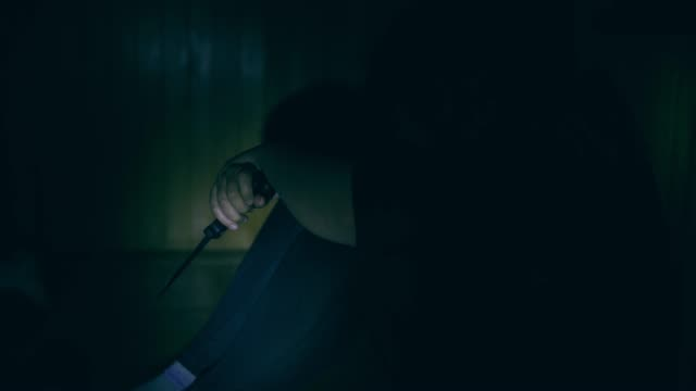 boy holding knife in dark, real time - fragility stock videos & royalty-free footage
