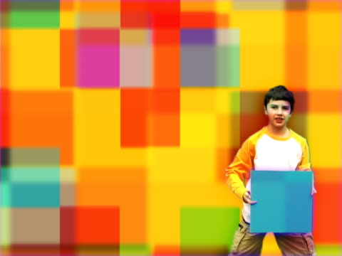Boy Holding Square over Multicolored Pattern