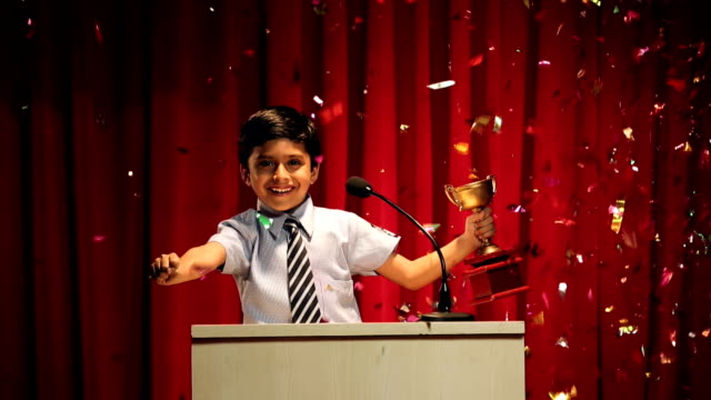 ms boy holding trophy celebrating the success at annual day - award stock videos & royalty-free footage