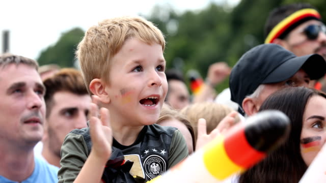 A boy in a German football shirt is happy and is clapping during Germany is loosing the 2018 FIFA World Cup Russia Group F match against Korea...