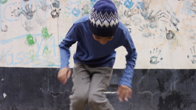 boy in a knit hat dancing in backyard - pre adolescent child stock videos & royalty-free footage