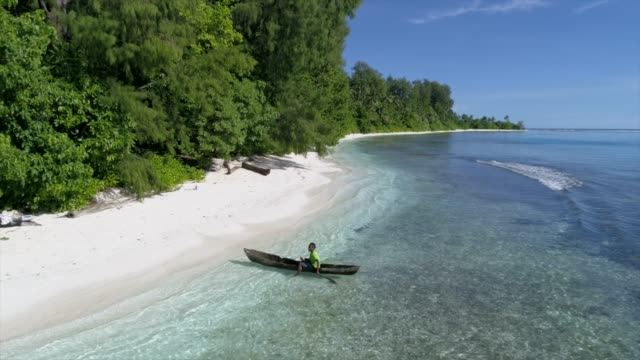 boy in a tropical beach boat - papua new guinea stock videos & royalty-free footage