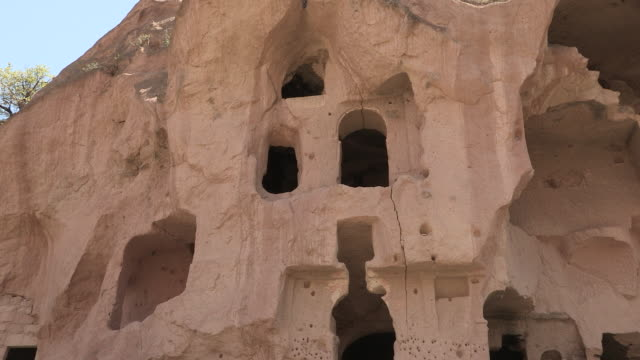 boy in cave window, cappadocia, turkey - cappadocia stock videos and b-roll footage