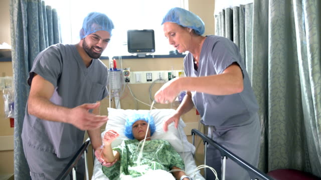 boy in children's hospital with doctors - surgical cap stock videos & royalty-free footage