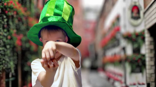 boy in green irish hat on st's patrick day - illusion stock videos & royalty-free footage