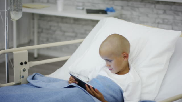 boy in hospital watching movie - completely bald stock videos and b-roll footage