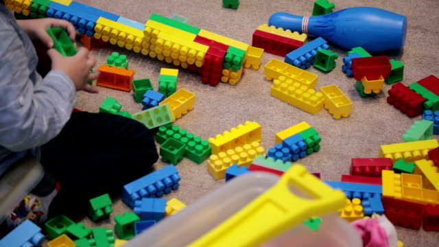 boy in kindergarten playing with toy blocks - nursery school building stock videos and b-roll footage