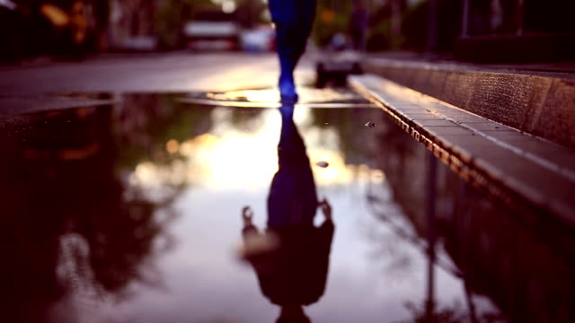 boy in puddle - puddle stock videos & royalty-free footage