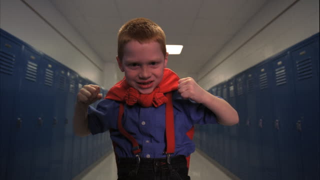 ms ds rear pov boy (5-6) in school corridor, striking hero pose, oshkosh, wisconsin, usa - flexing muscles stock videos and b-roll footage