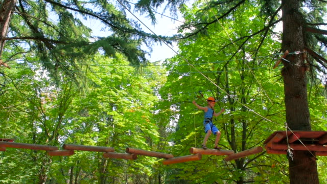 boy in the municipal rope park in summer - boy scout stock videos and b-roll footage