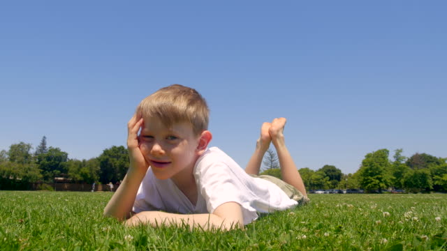 boy in the park - barefoot stock videos & royalty-free footage
