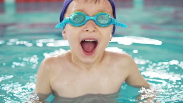boy in the swimming pool - swimming pool stock videos & royalty-free footage