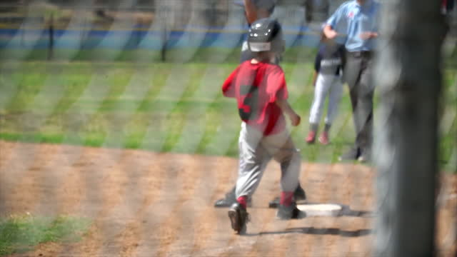 a boy is at bat while playing little league baseball. - slow motion - boys stock videos & royalty-free footage