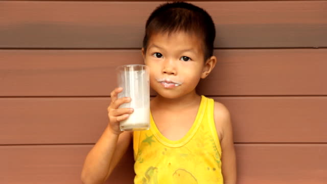 Boy is drinking milk.