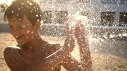 boy is poured water jet from a shower