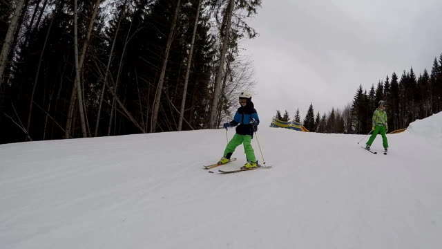 boy is skiing with her mother. - winter sport stock videos and b-roll footage