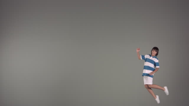 WS SLO MO Boy jumping in air