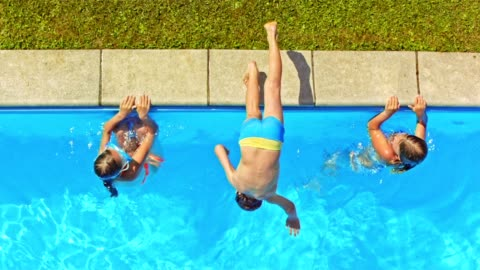 slo mo cs boy jumping in the pool doing a front flip - swimming goggles stock videos & royalty-free footage