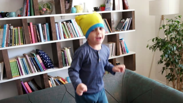boy jumping on sofa - one boy only stock videos & royalty-free footage