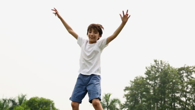 boy jumping on the trampoline - exhilaration stock videos and b-roll footage