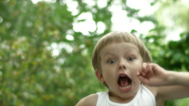 stockvideo's en b-roll-footage met boy jumping, slow motion - trampoline