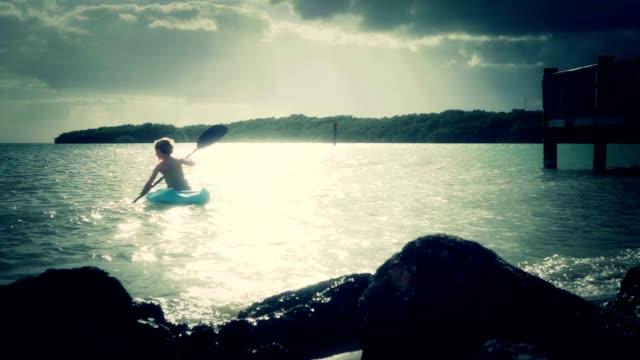 Boy Kayaking In The Ocean