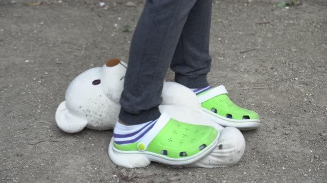 a boy kicking his teddy bear. - aggression stock videos & royalty-free footage