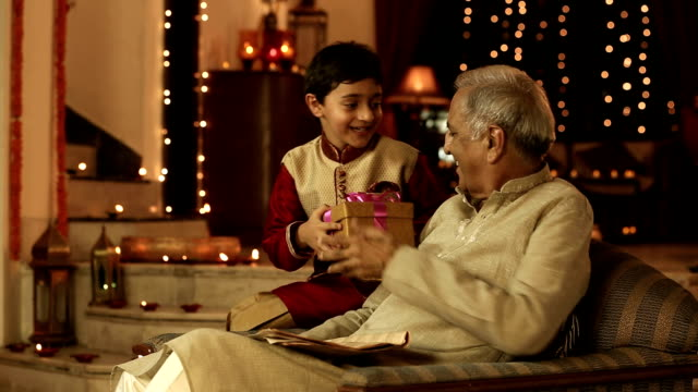 boy kid giving gift to his grandfather, delhi, india - grandfather stock videos & royalty-free footage