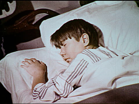 vídeos y material grabado en eventos de stock de / boy laying in bed falling asleep / boy dreams of a talking humansized bar of soap boy falls asleep - onírico