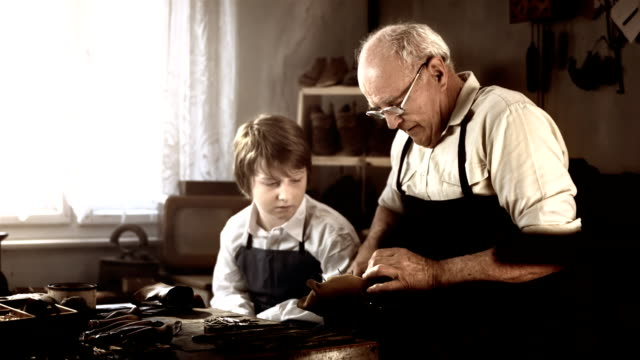 hd dolly: boy learning how to make shoes - grandfather stock videos & royalty-free footage