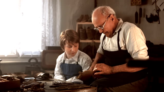 HD DOLLY: Boy Learning How To Make Shoes