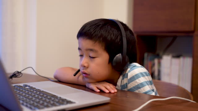 boy learning online with computer and boring - boredom stock videos & royalty-free footage