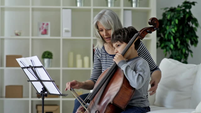 boy learning to playing cello - teacher stock videos & royalty-free footage