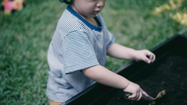 boy learns to dig the soil - digging stock videos & royalty-free footage