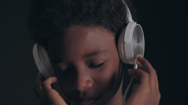 boy listening to music - african american culture stock videos & royalty-free footage