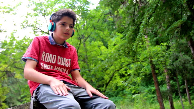 boy listening to music - 14 15 years stock videos and b-roll footage