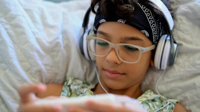 boy listening to music with headphones - 8 9 years stock videos & royalty-free footage