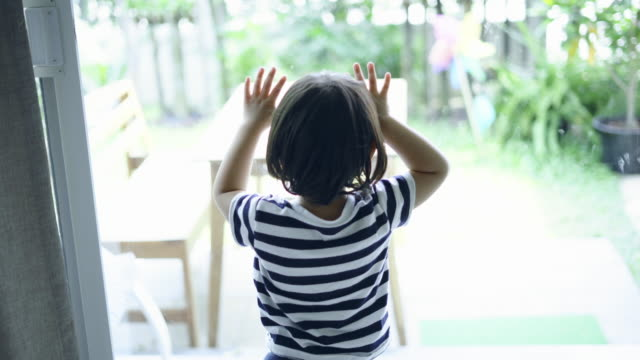 a boy looking at the front door of the house - front door stock videos & royalty-free footage