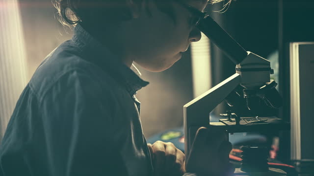 Boy looking at the microscope