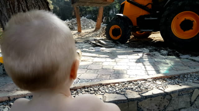 boy looking at the tractor in work - digging stock videos & royalty-free footage