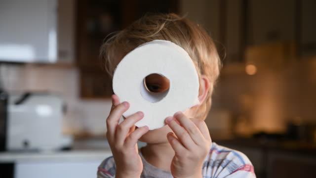 boy looking into improvised binoculars - bathroom stock videos & royalty-free footage