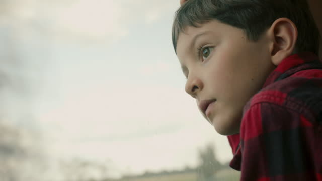 boy looking out of train window - daydreaming stock videos & royalty-free footage