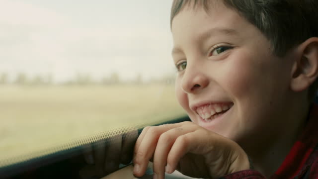 boy looking out of train window - one boy only stock videos & royalty-free footage