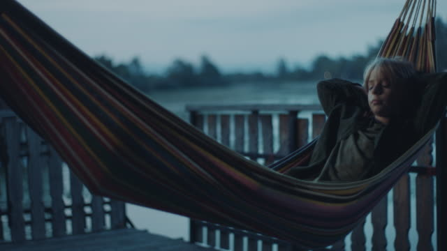 boy lying down in hammock - cottage stock videos & royalty-free footage